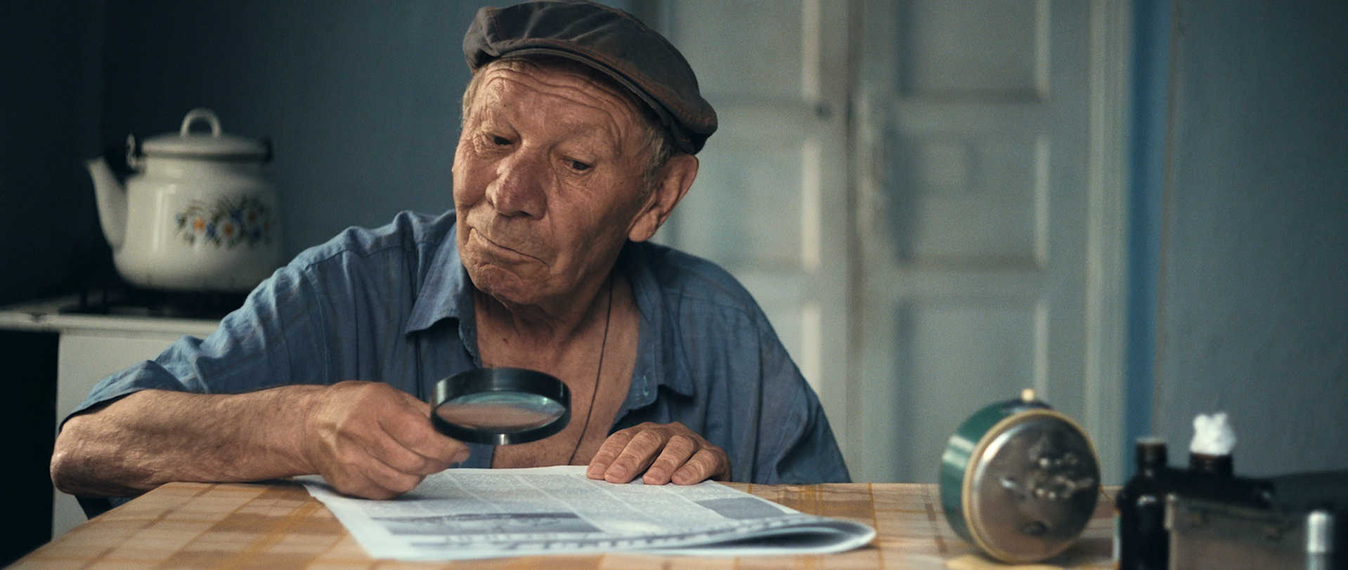 MILIARD - Uncle Ghoerghe reading newspapers.jpg